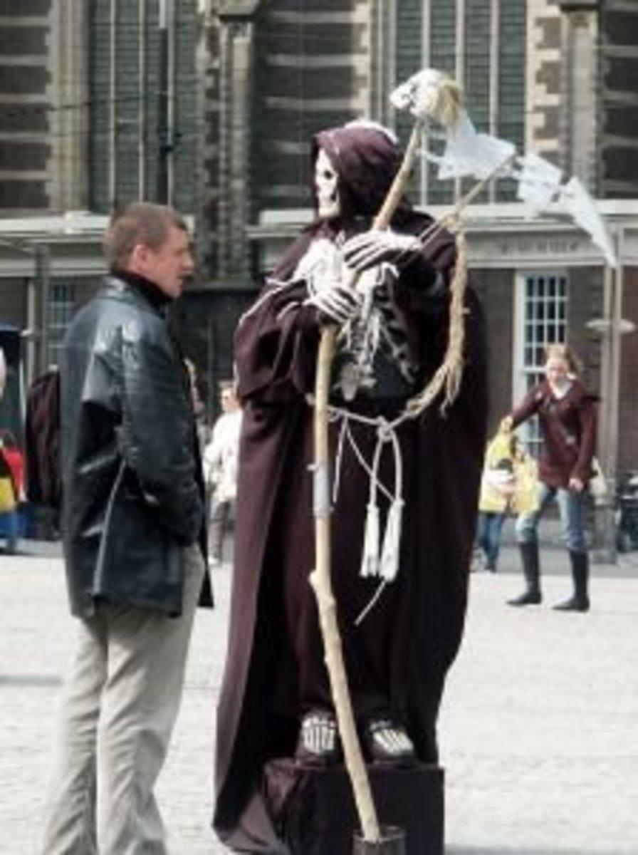 Death chatting it up on the street. Source:  sxu.hu/jwarletta