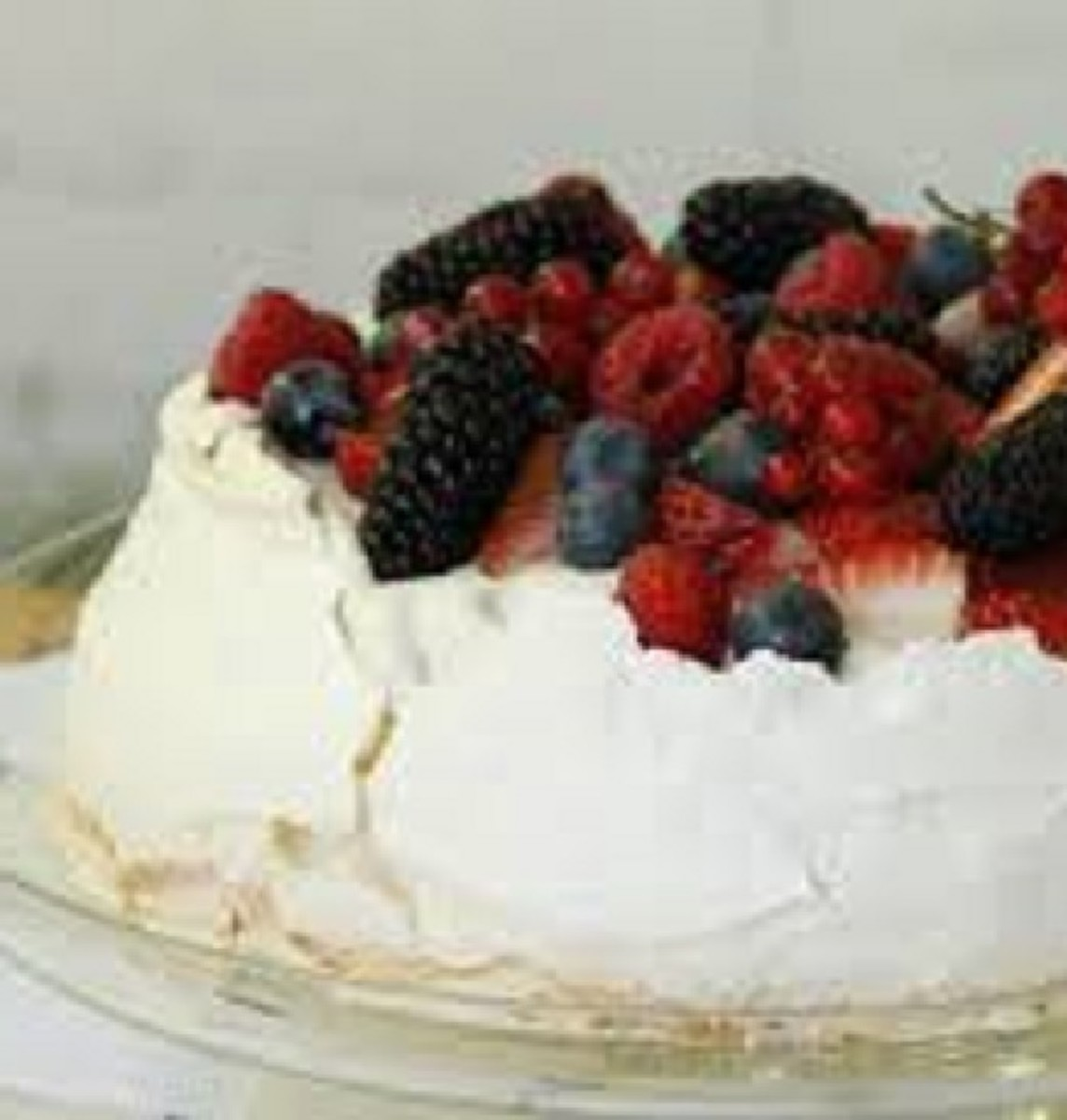 Wattelseed pavlova with fruit topping. This is a dish often enjoyed during Christmas Week.