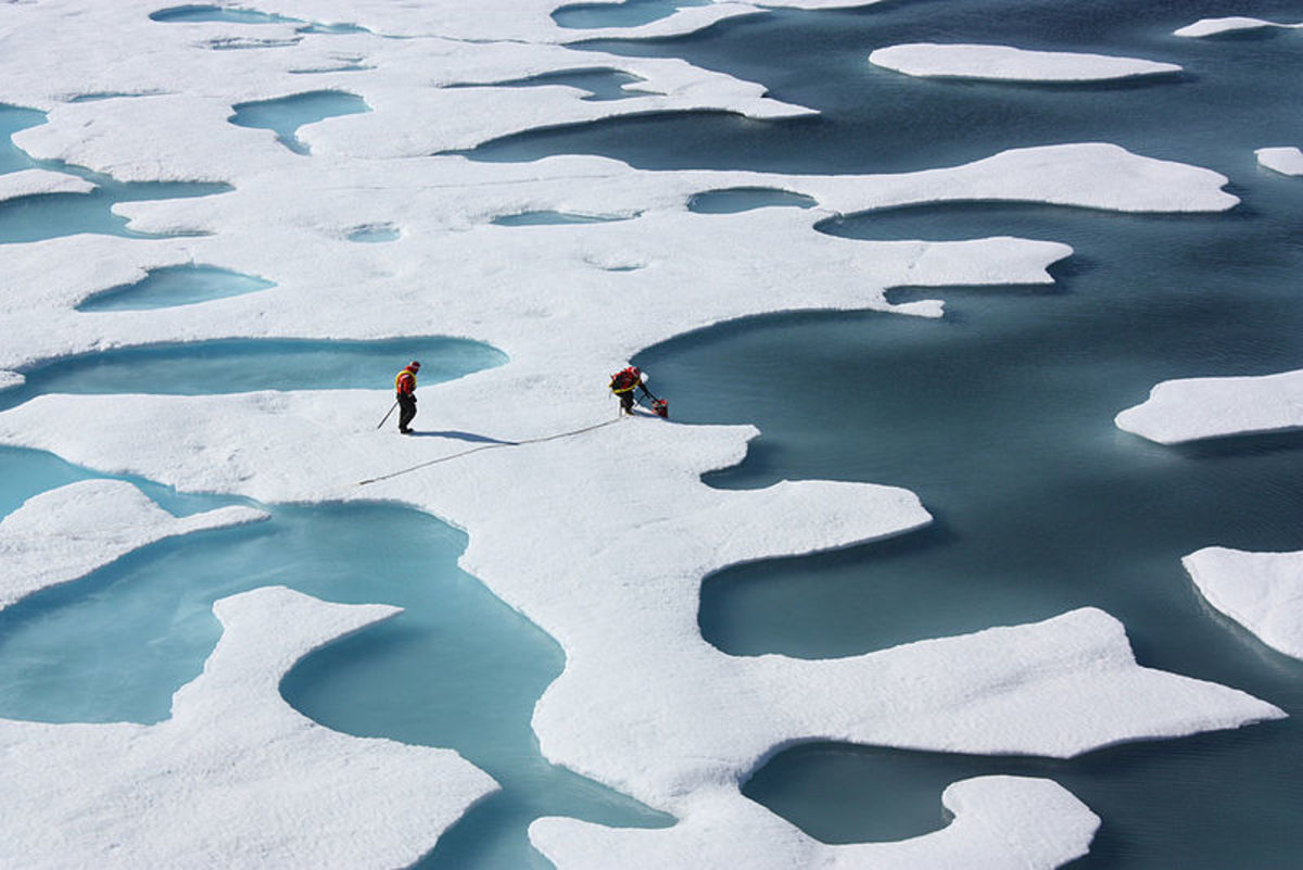 """""""Ponds on the ocean.""""  ICESCAPE investigators work Arctic Ocean melt ponds, July 2011.  Photo courtesy NASA and Wikimedia Commons."""