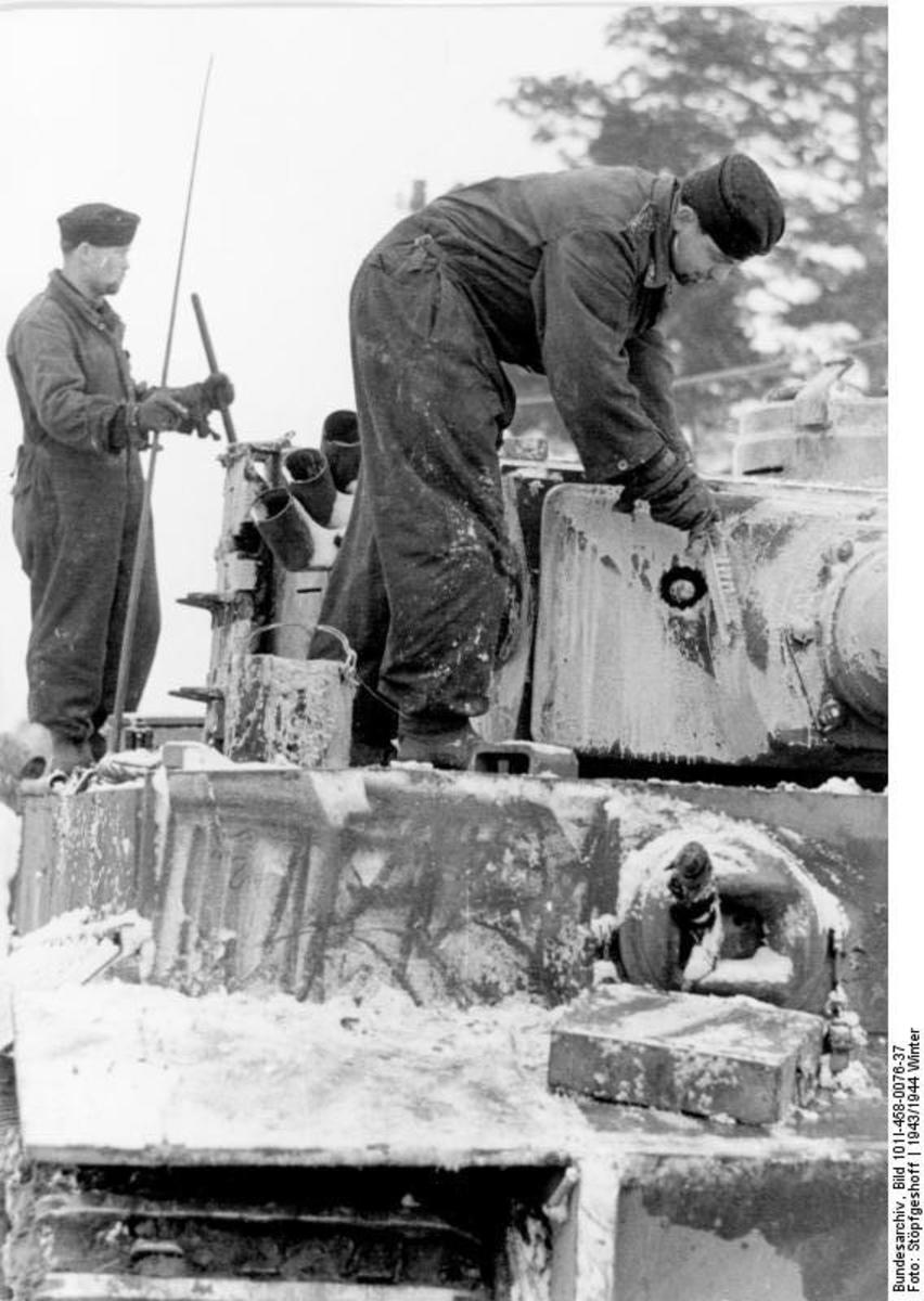 German Troops painting their tanks white for winter camouflage.