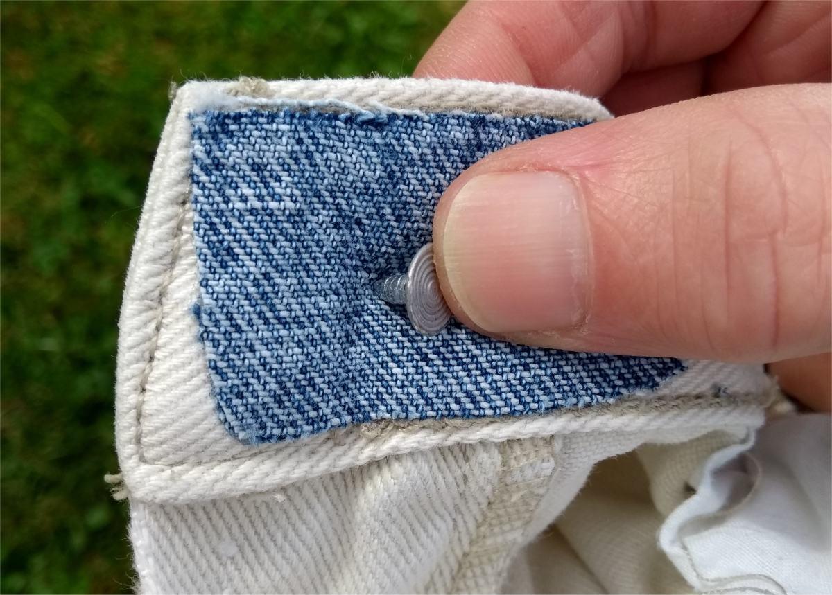 Push the pin through the fabric.