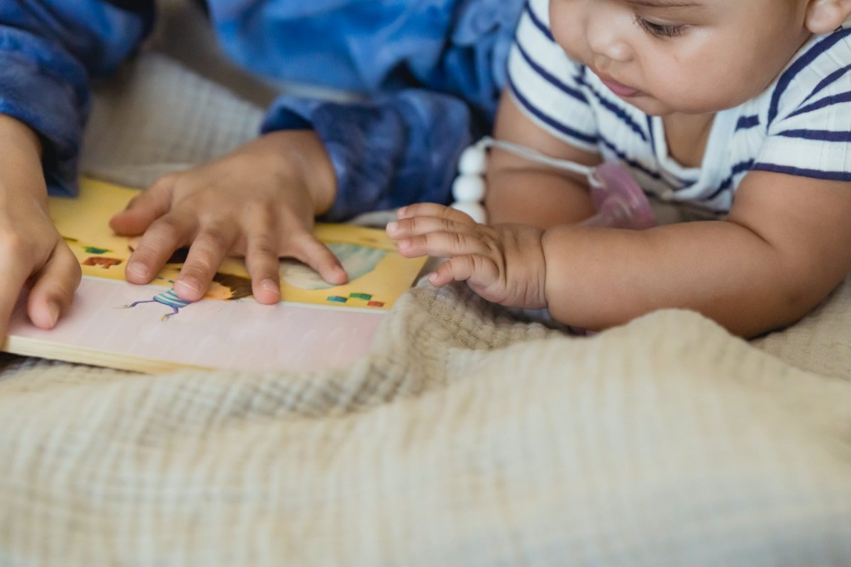 Reading to babies is a great bonding activity for big siblings