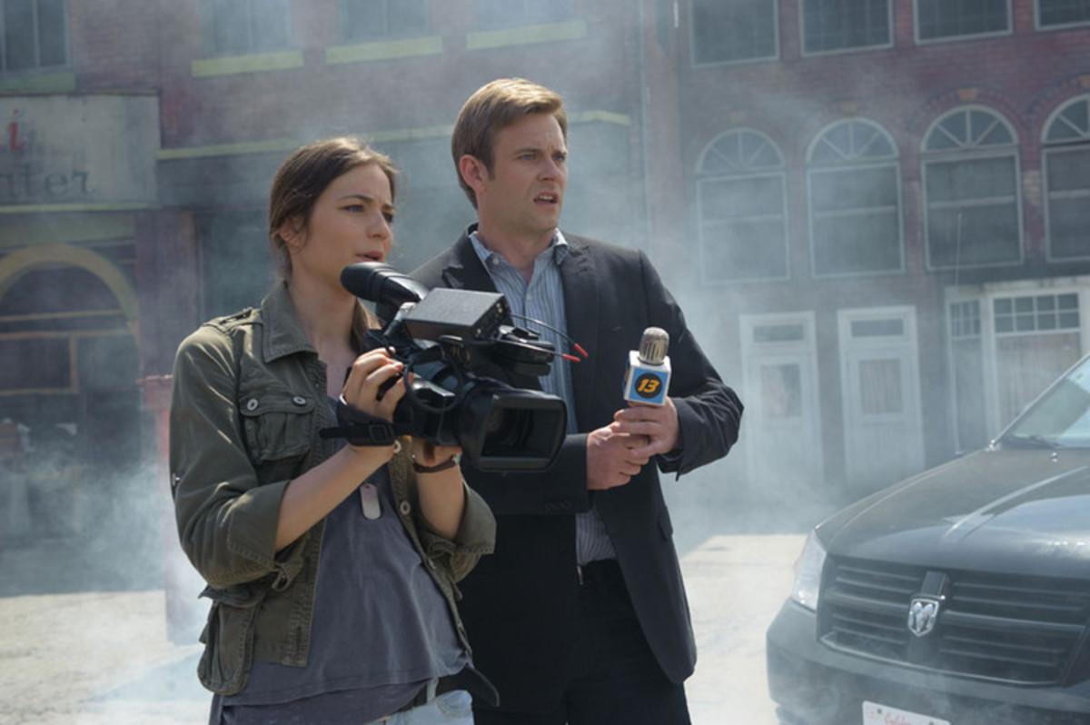 Lena (Lara Gilchrist) and Kyle (Eric Johnson) chase falling meteors throughout San Francisco