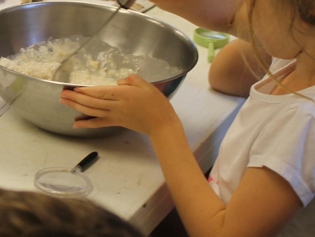 Adding flour and mixing the dough