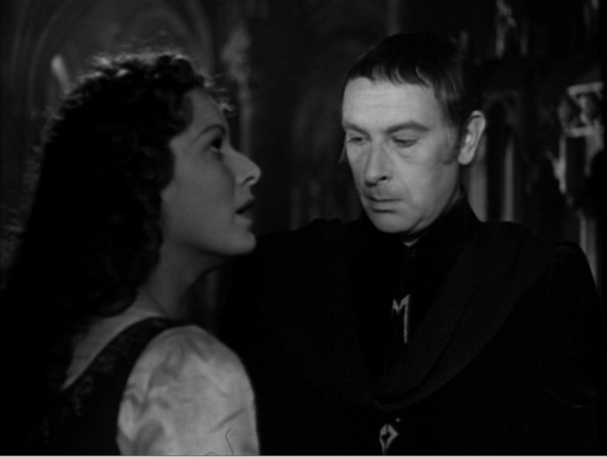 Sir Cedric Hardwicke as Frollo with Maureen O'Hara as Esmeralda, The Hunchback of Notre Dame 1939