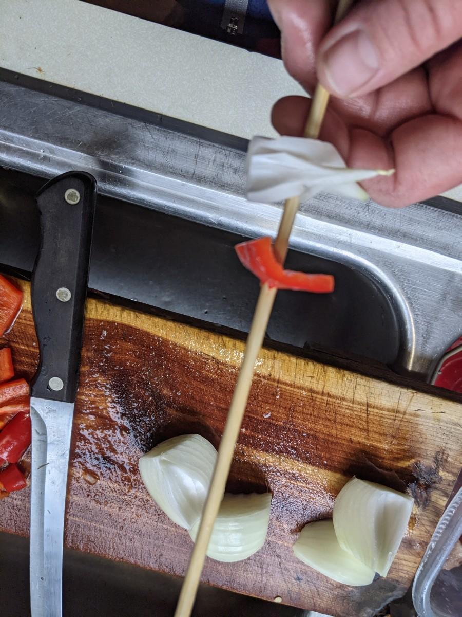 Poke stick into pepper
