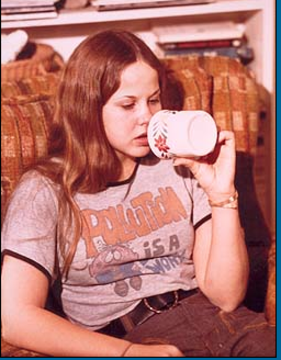 After a tough day of school, Sarah (Linda Blair) relaxes with a bottle of vodka