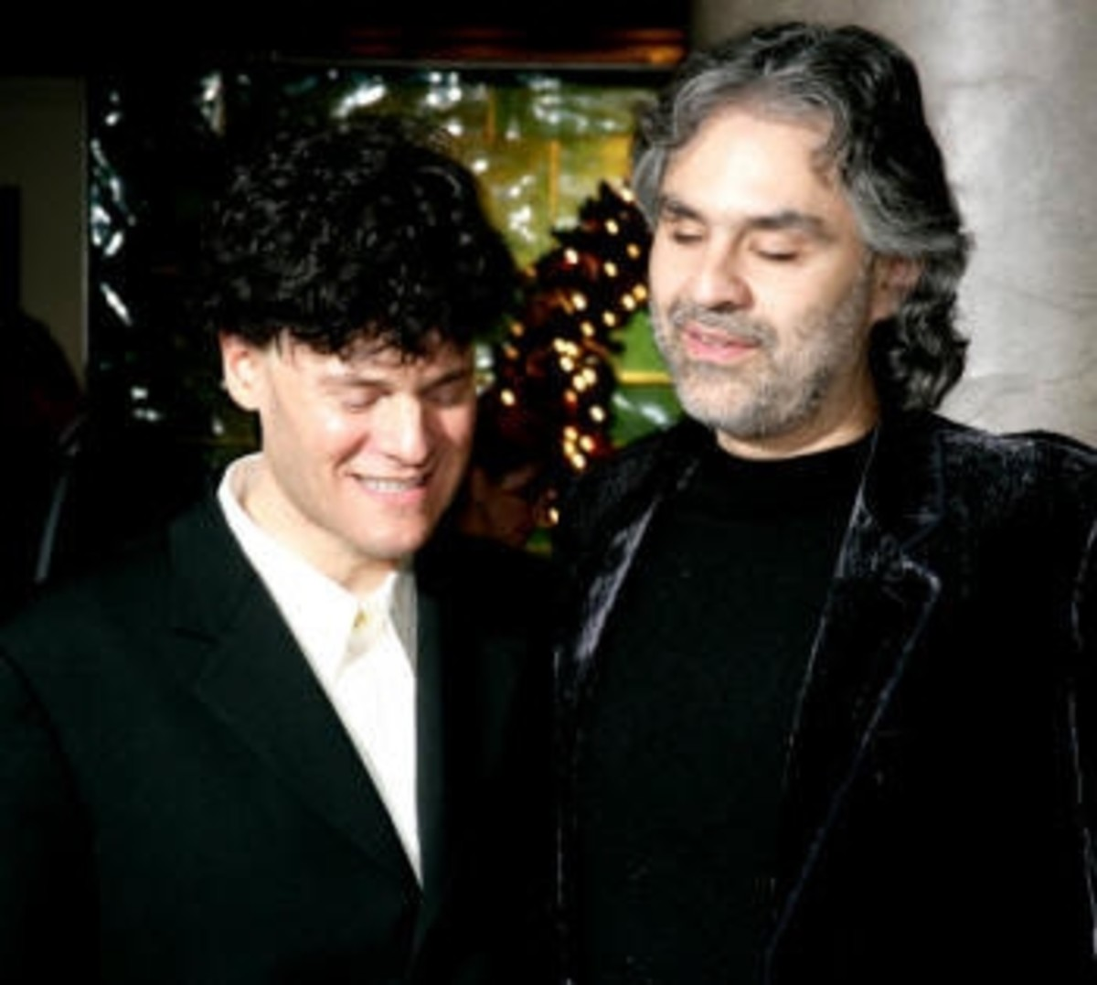 Drew and Andrea Bocelli share a moment at a Bocelli foundation event where Drew was asked to perform.