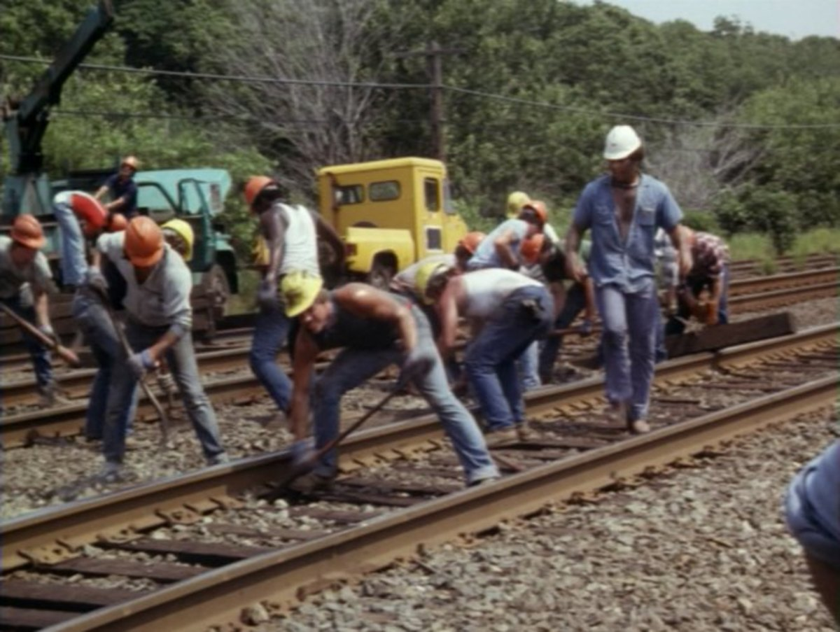 Railway employees work feverishly to avoid a collision of two passenger trains
