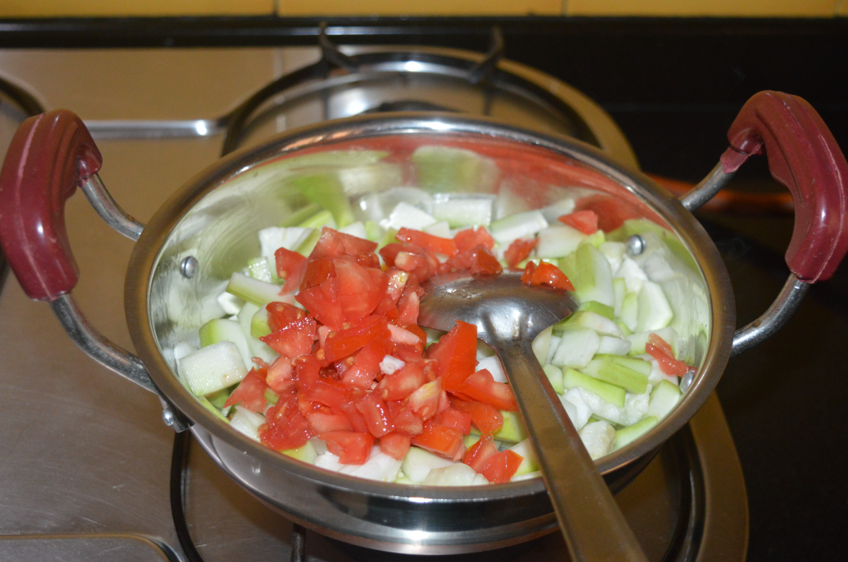 Add chopped tomatoes and salt.