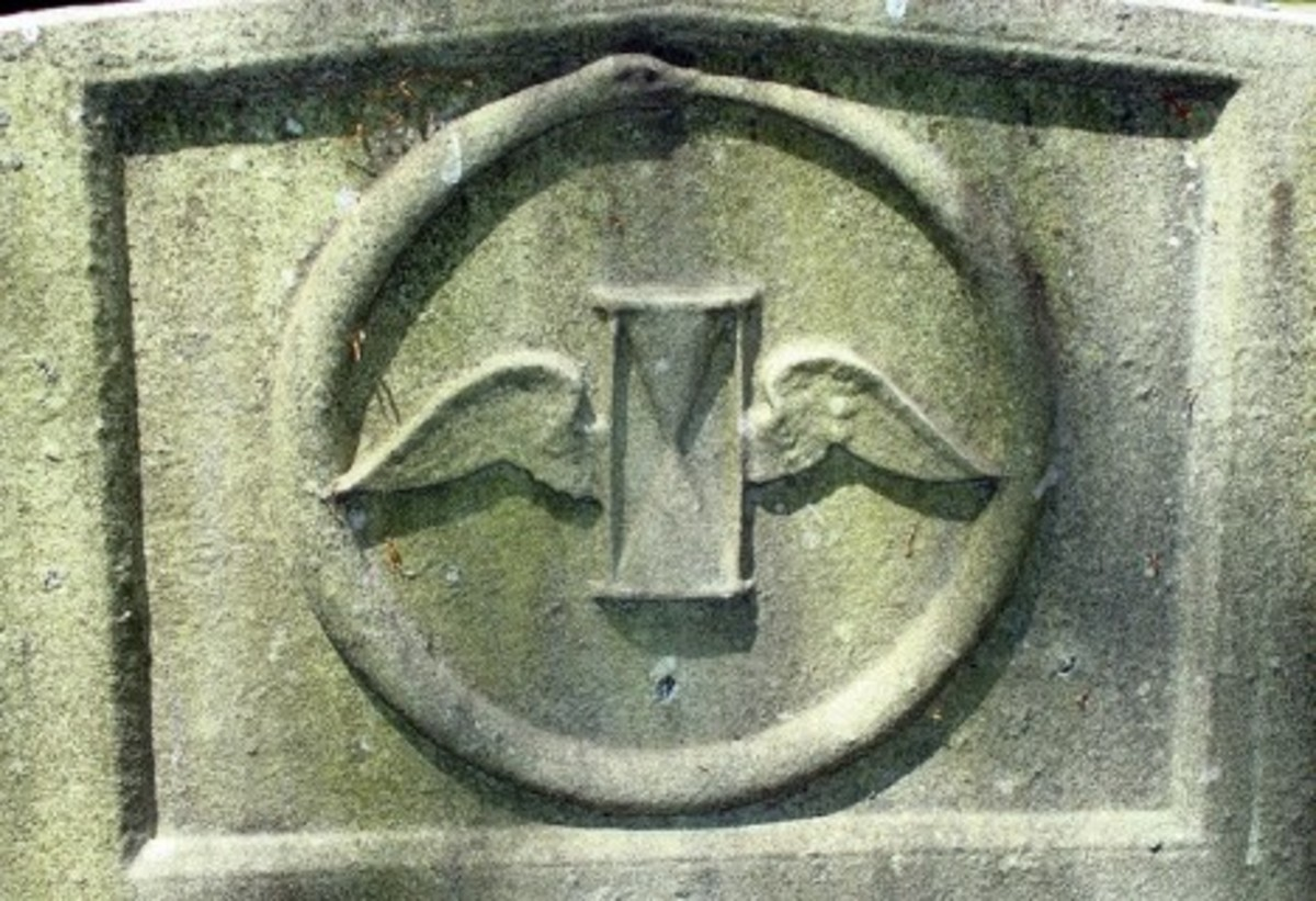 An hourglass on a tombstone.