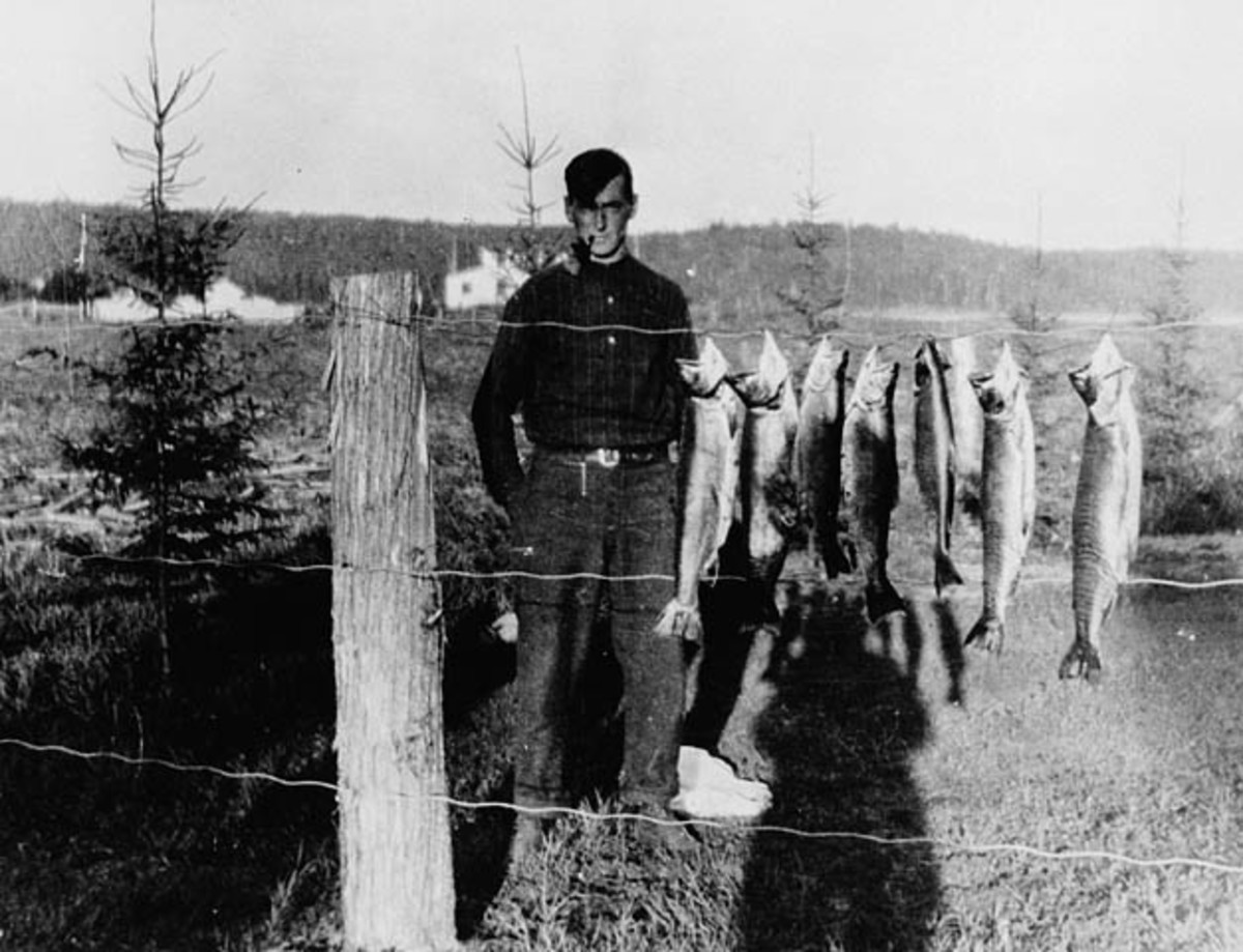 Thomson loved fishing. He is seen here with a catch of trout at Canoe Lake.