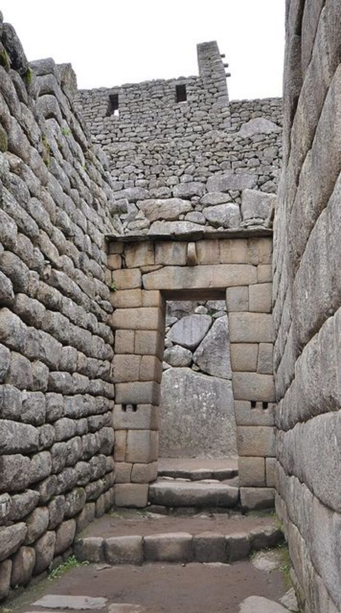 Inca architecture - The use of dry-stone walls (Ashlar) - Machu Picchu  The central buildings of Machu Picchu use the classical Inca architectural style of polished dry-stone walls of regular shape.
