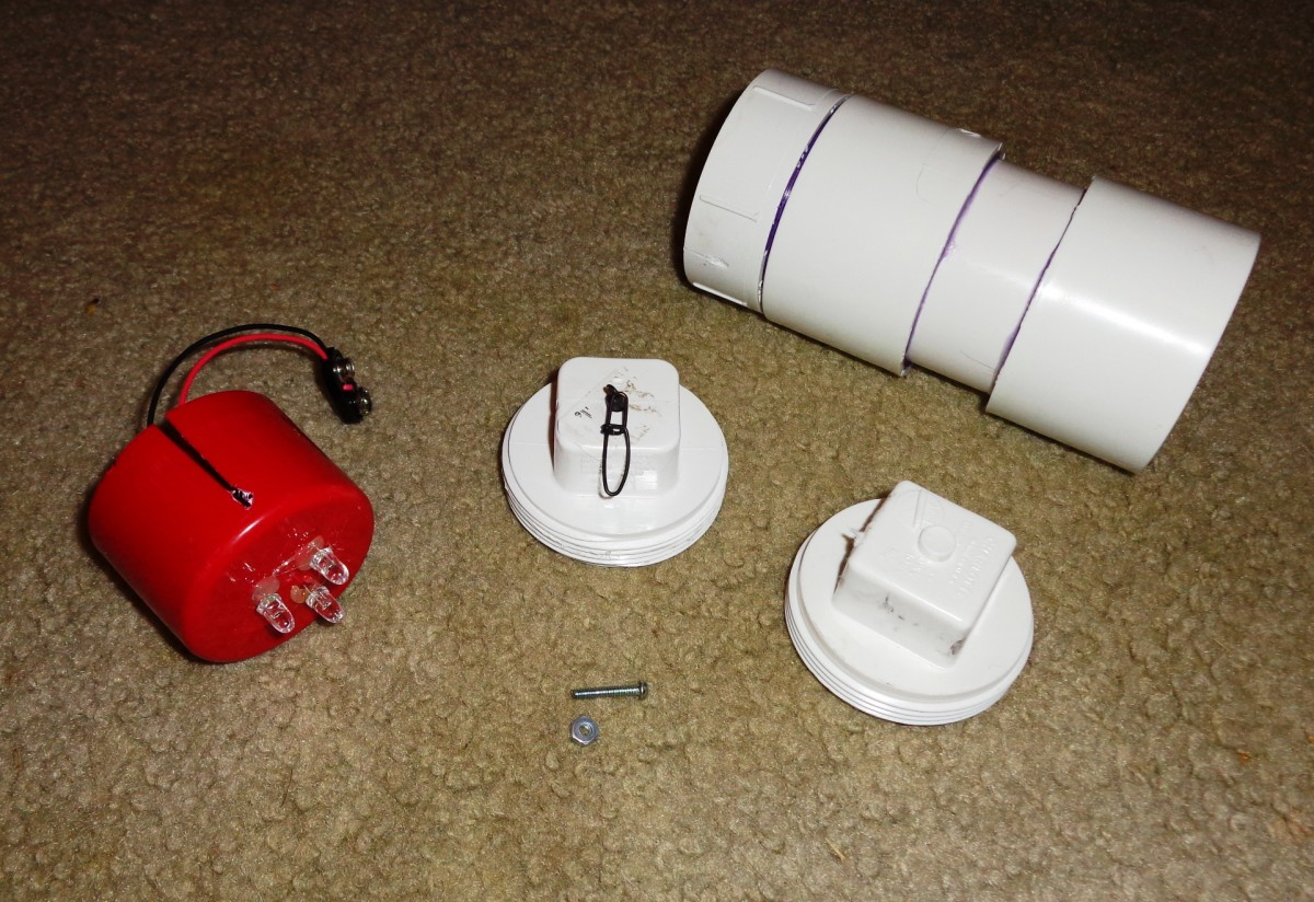 LED Circuit, PVC Body, Small Machine Bolt and Nut, two variations of the PVC Threaded Plug