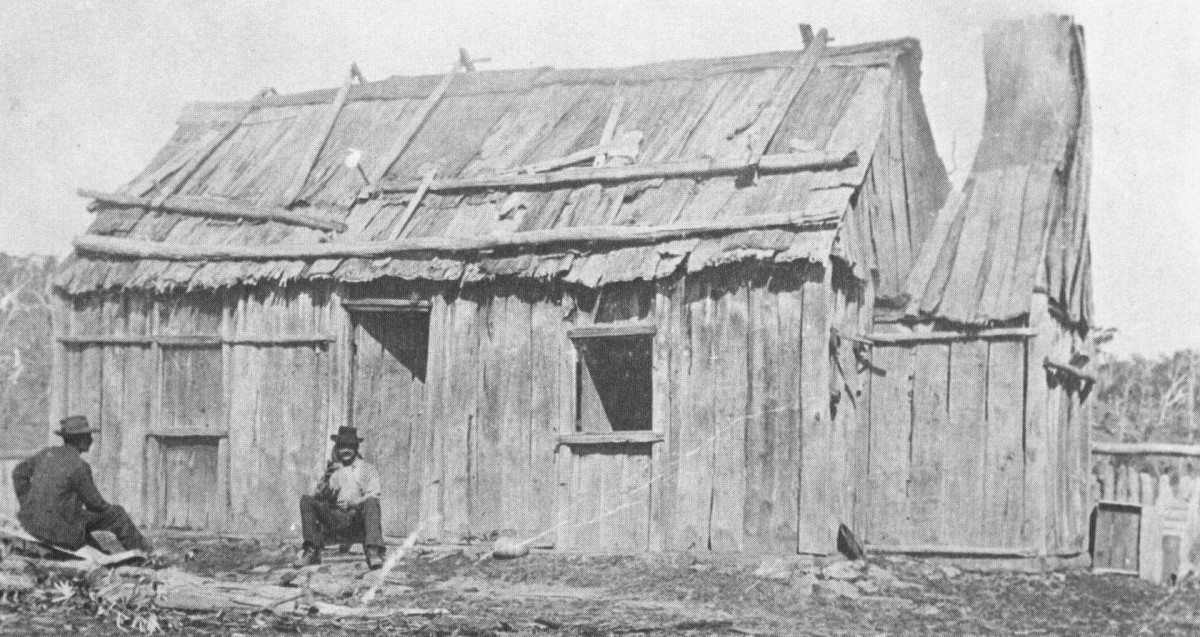First Settlers: A hut with timber slab walls and a bark roof, Belle Vue Station, Glencoe, NSW