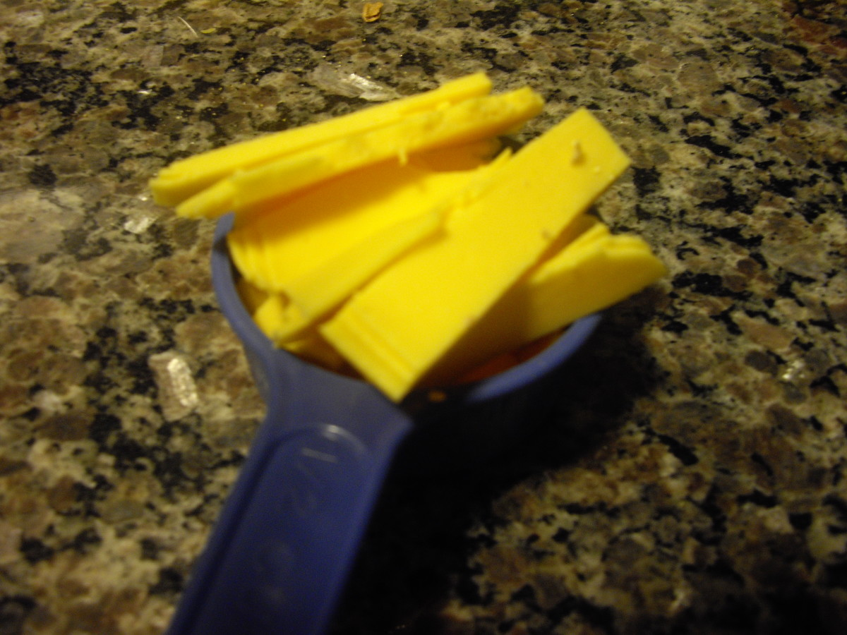 Measure out the cheese and remaining ingredients, in preparation of putting the pizza together