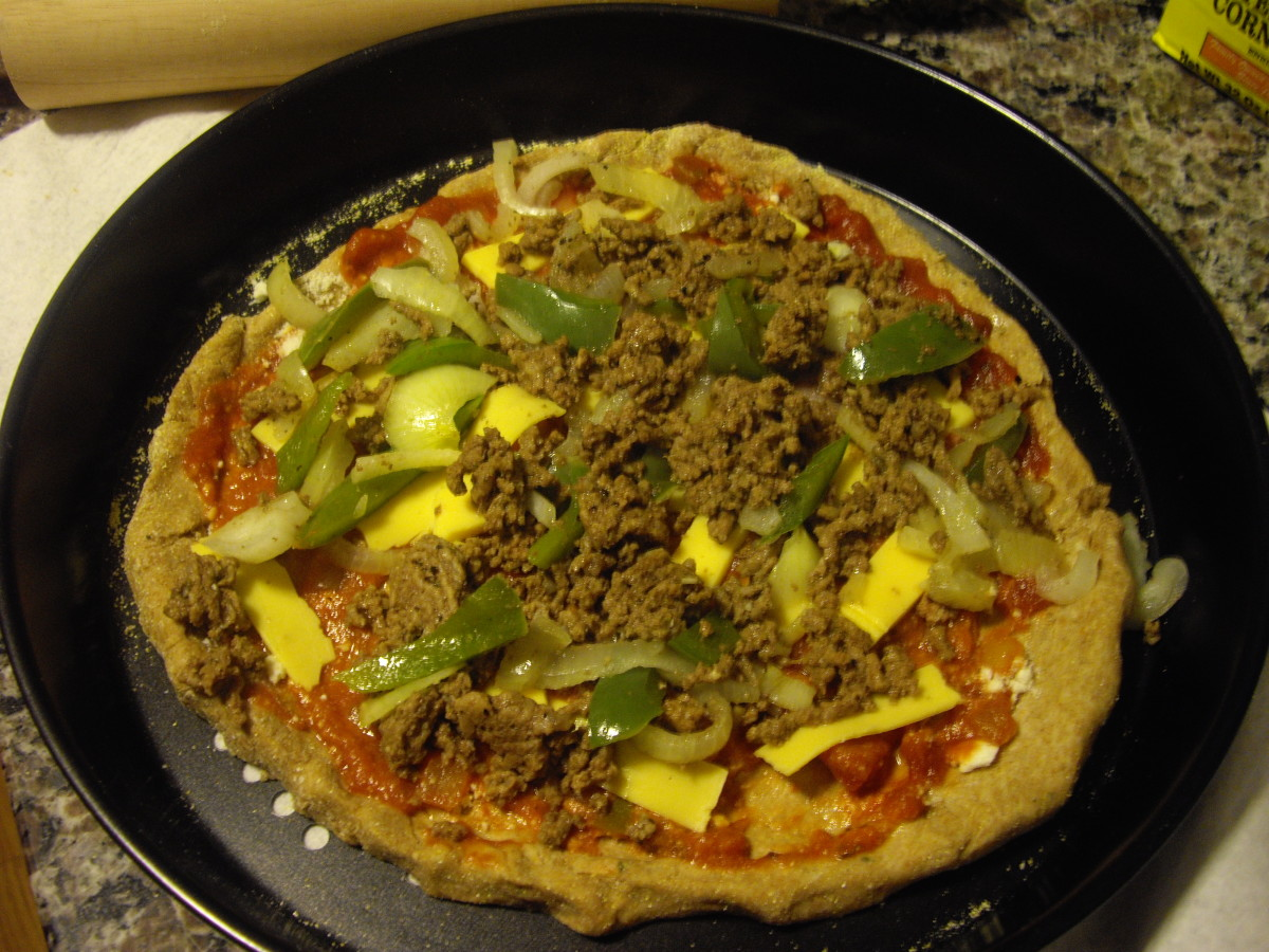 Add meat and veggies, as well as the black olives if desired