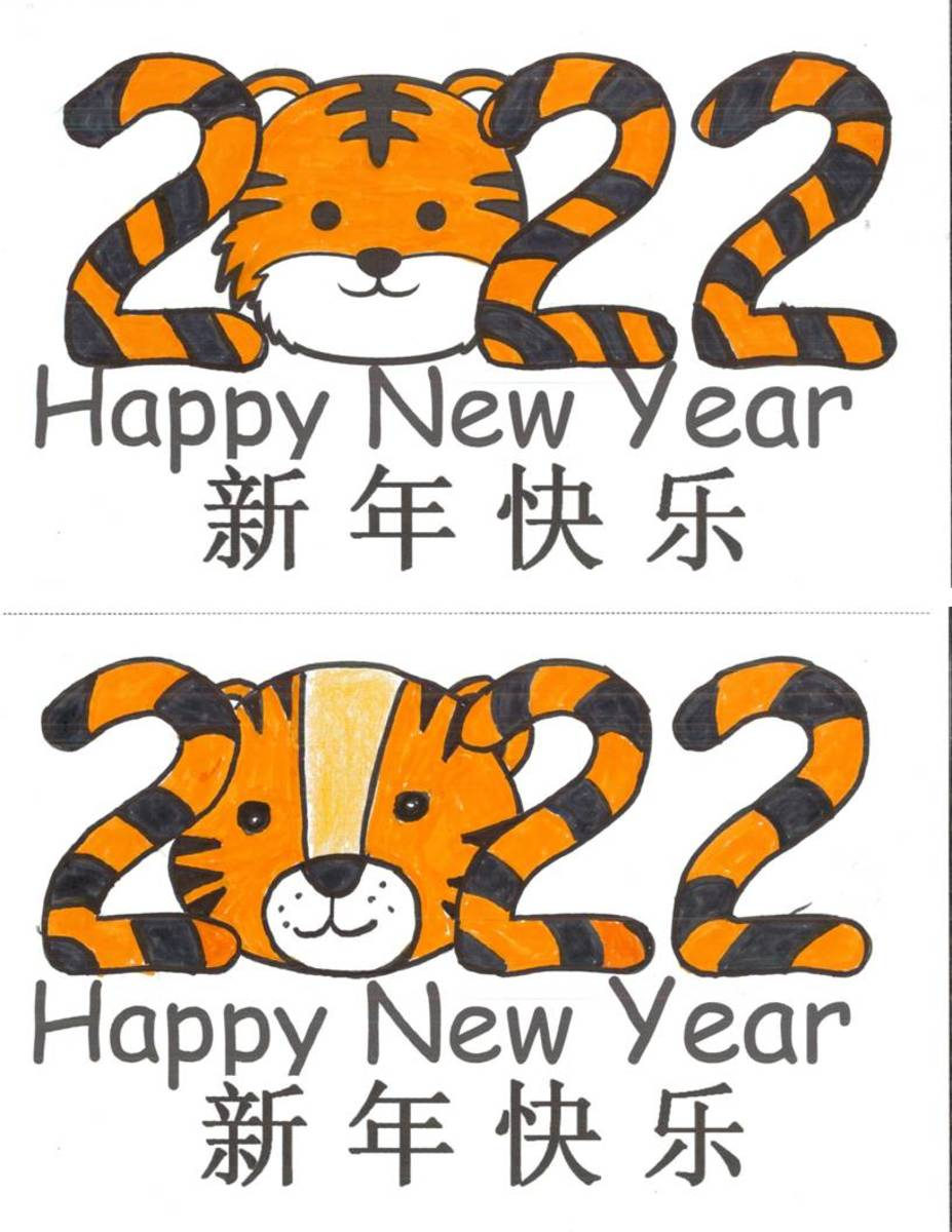 """For these cards, stripes were drawn on the numbers and then colored black and orange. For the bottom card, a child drew a tiger face in the blank spot where the """"0"""" goes."""