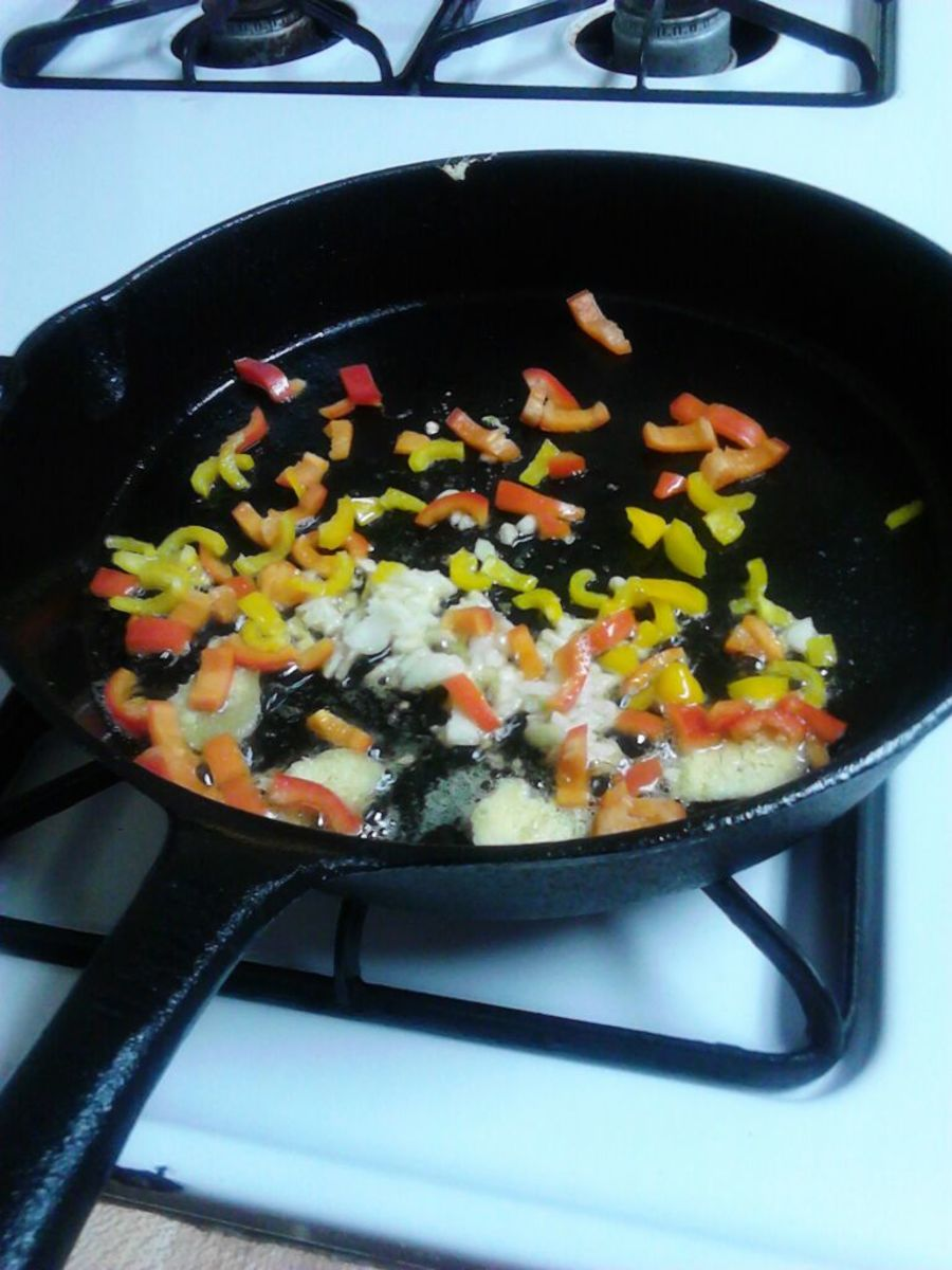 Heat skillet, pile on the goods and sautee.