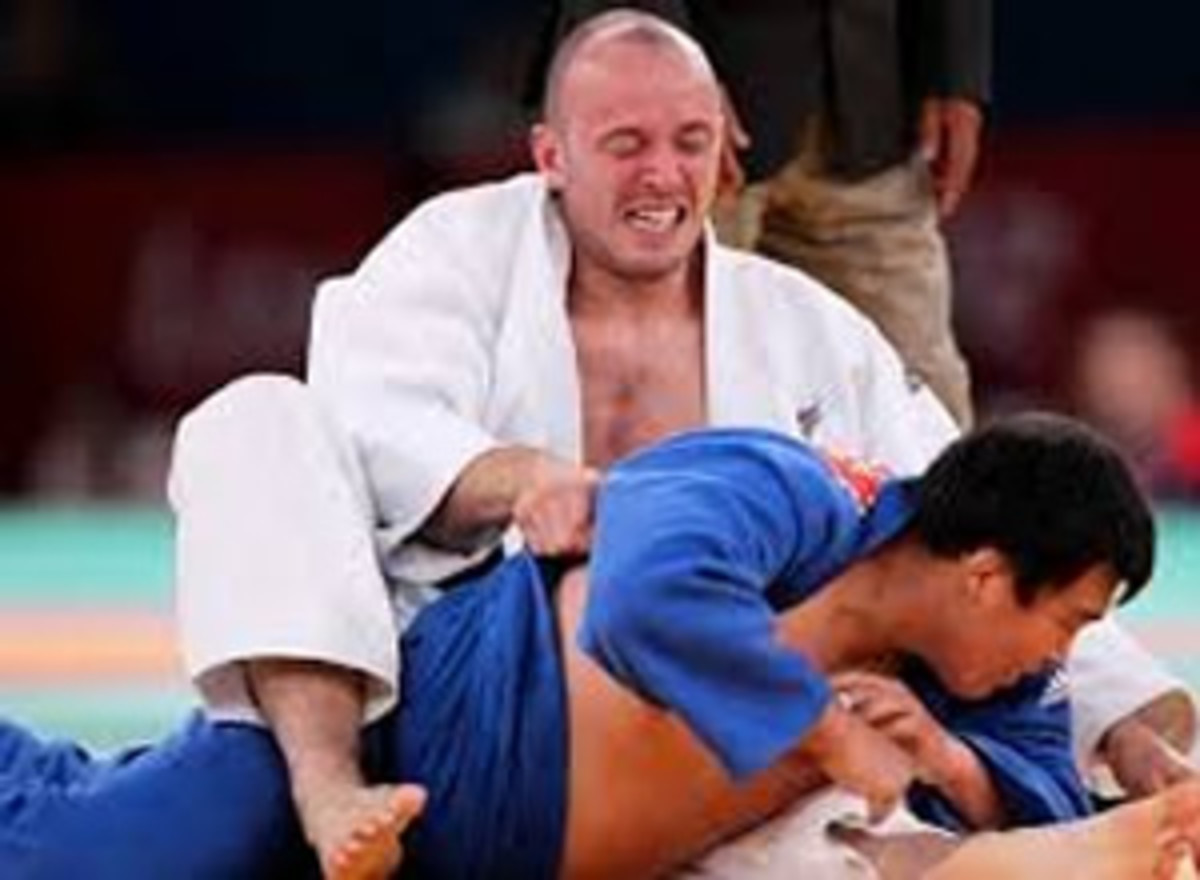 Men with intellectual disabilities compete in a judo competition. Competition boosts self-esteem.