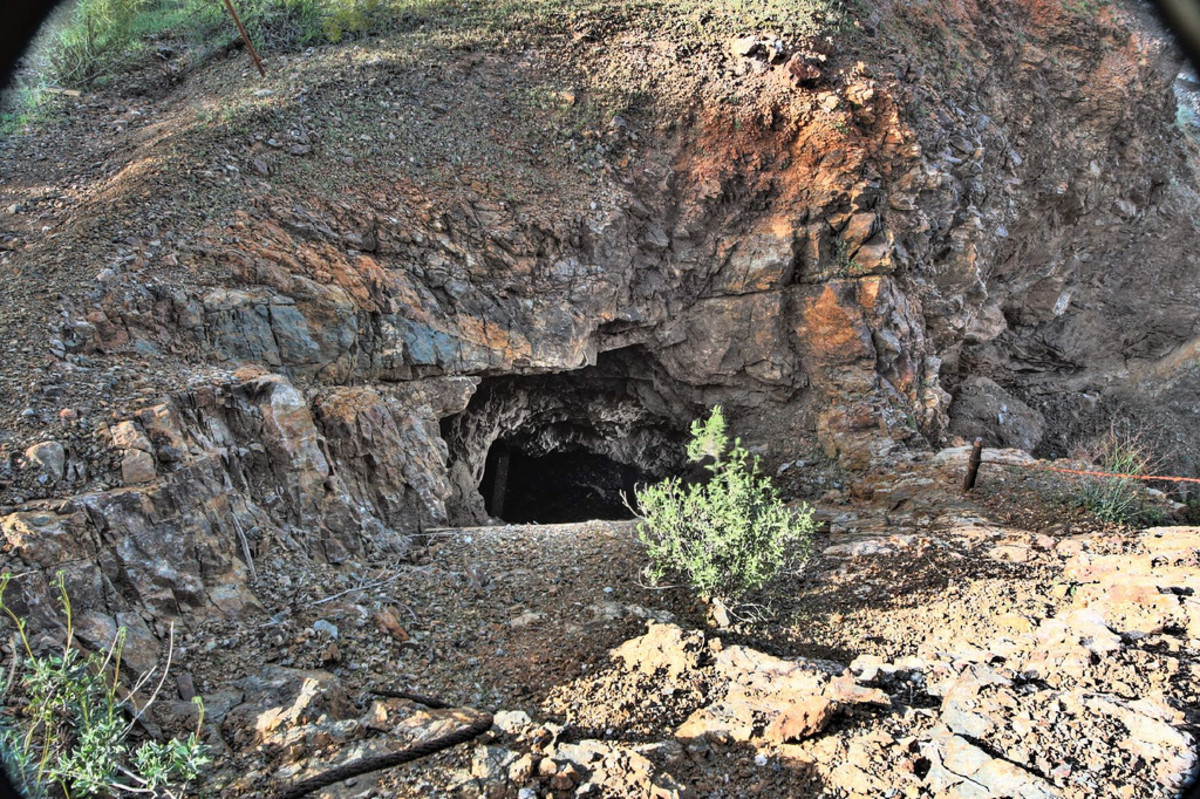 The abandoned mine shaft outside of town.