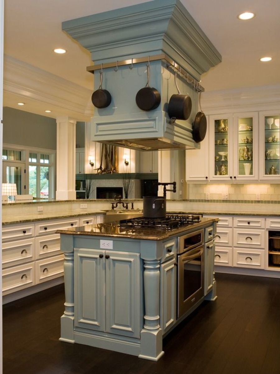 Green Kitchen Island With Pot Rack Circling Range Hoodimage credit- hgtv.com