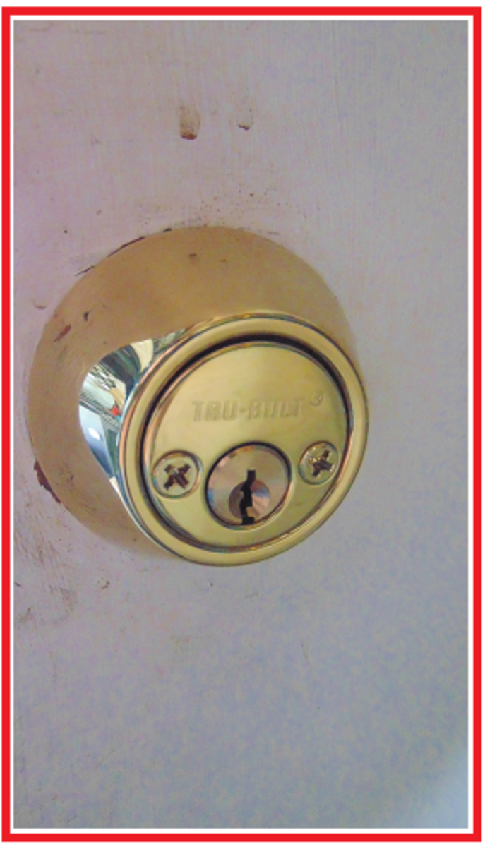Don't make it easier for the crooks to break in by screwing together the deadbolt lock from the outside.