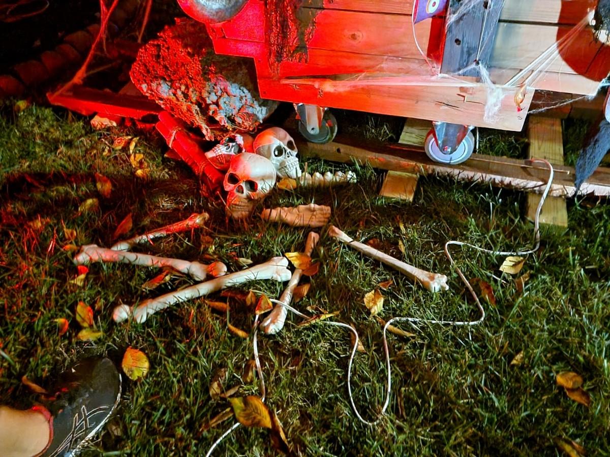 Creepy skeleton bones next to the rail car and railroad tracks for the mining scene.