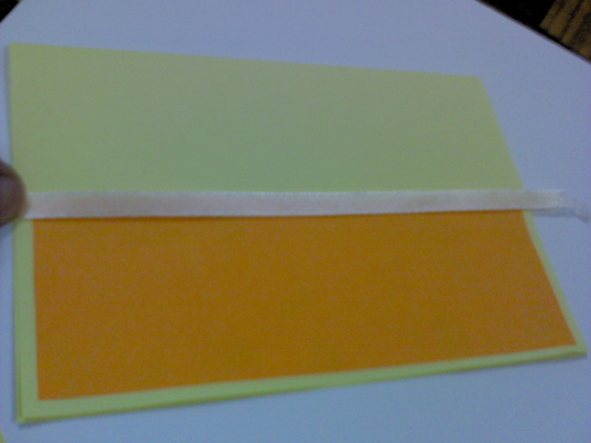 Cut out a strip of ribbon same length as the front card