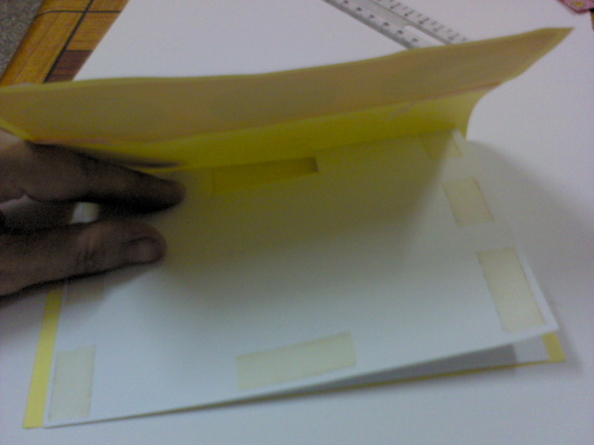 Paste double sided tape on all four sides, both top and bottom card
