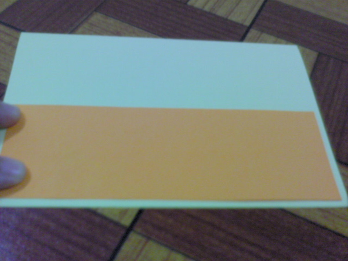 Paste orange paper at the bottom of the front card