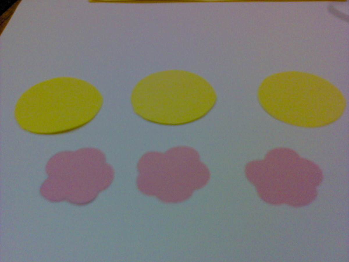 cut out 3 yellow circles and pink flower shapes