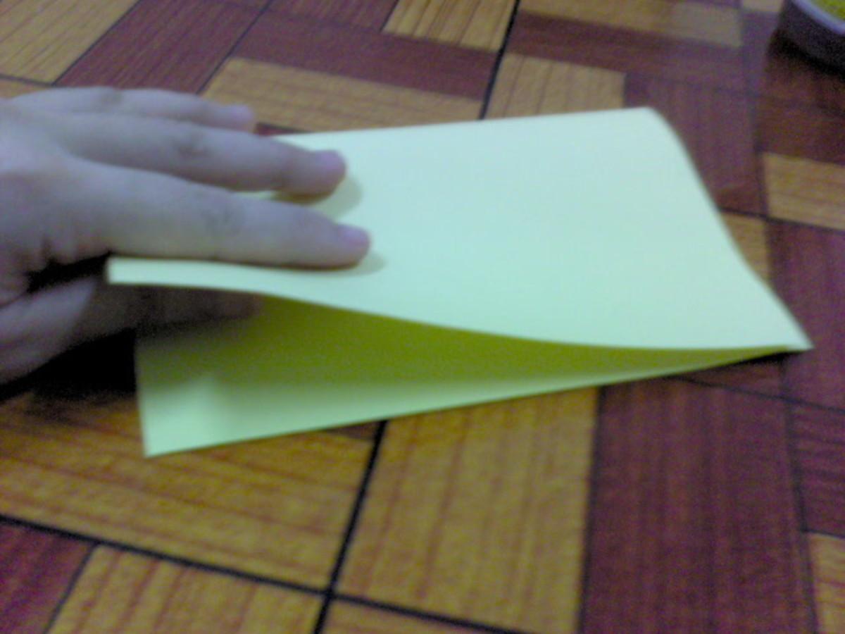 Fold yellow paper into half