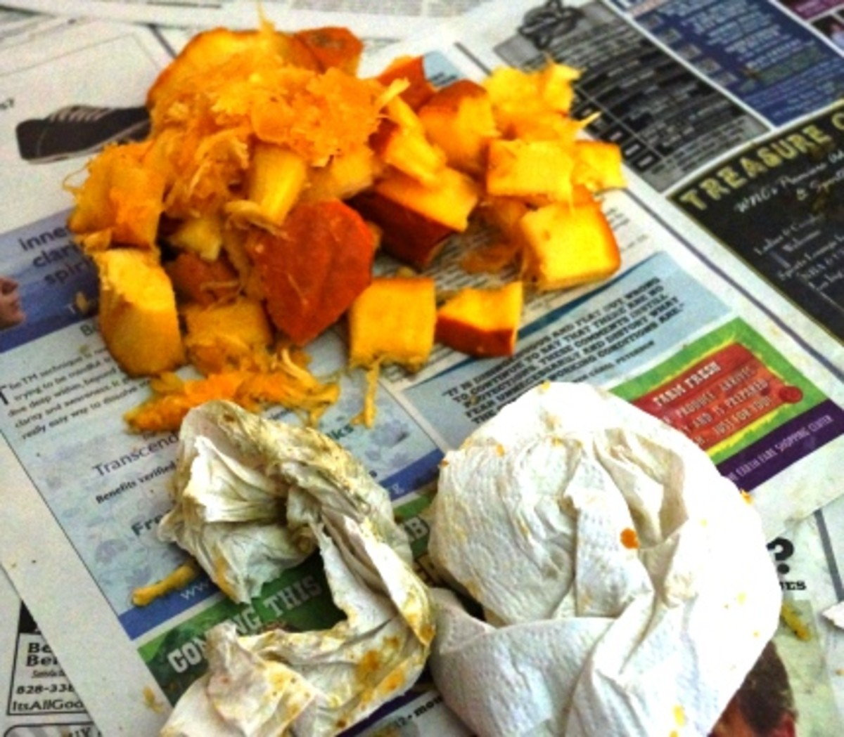 Chunks of pumpkin cut-out, paper towels and newspaper are all destined for the compost pile.