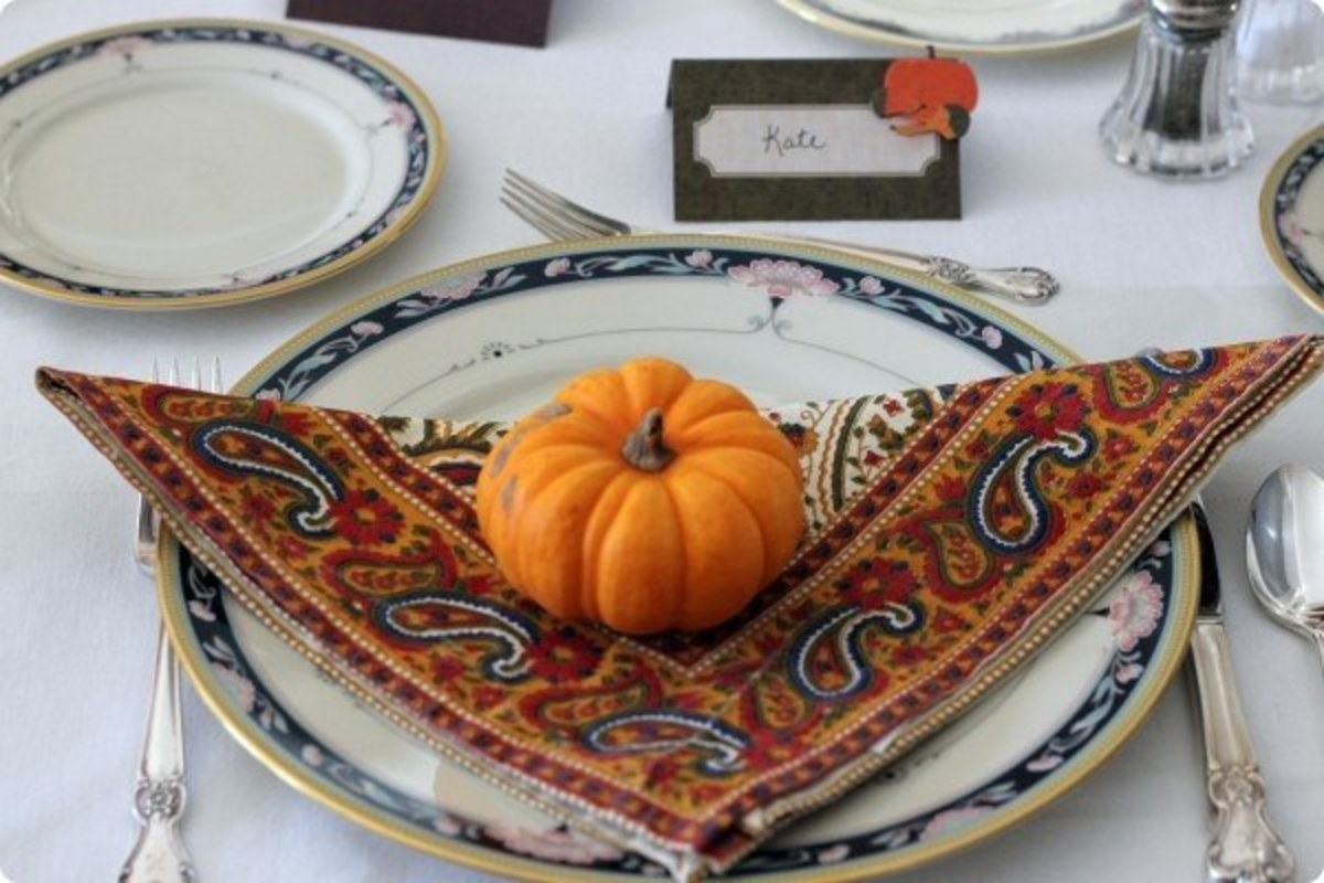 Make a simple place setting with a small pumpkin and a lovely cloth napkin.