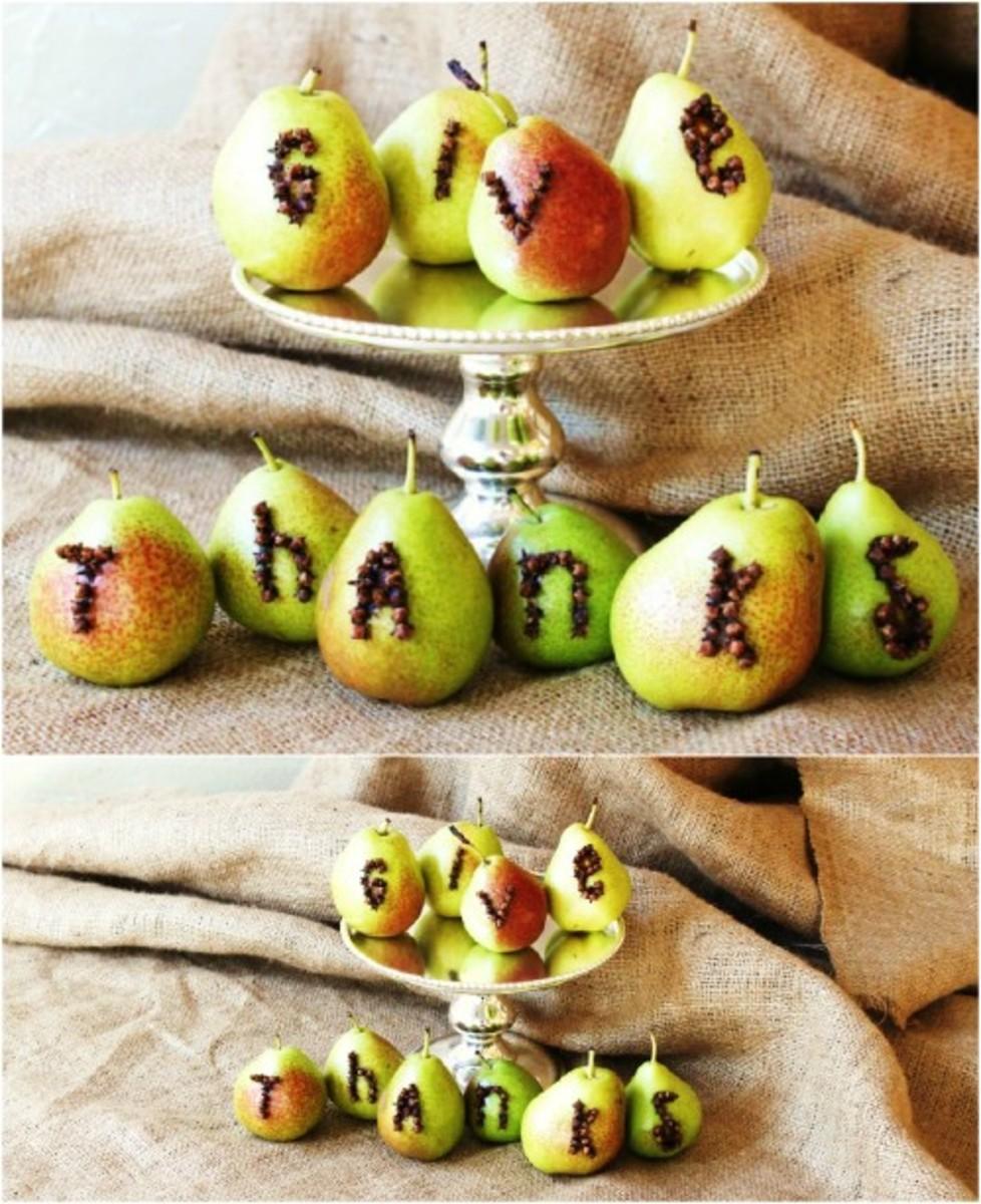 Push cloves into fruit to create a unique centerpiece.