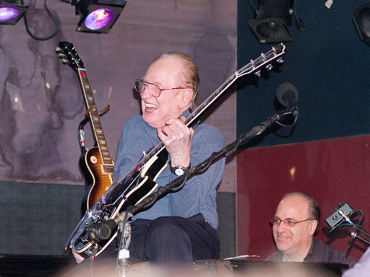 Les Paul and his friends playing music and laughing together.