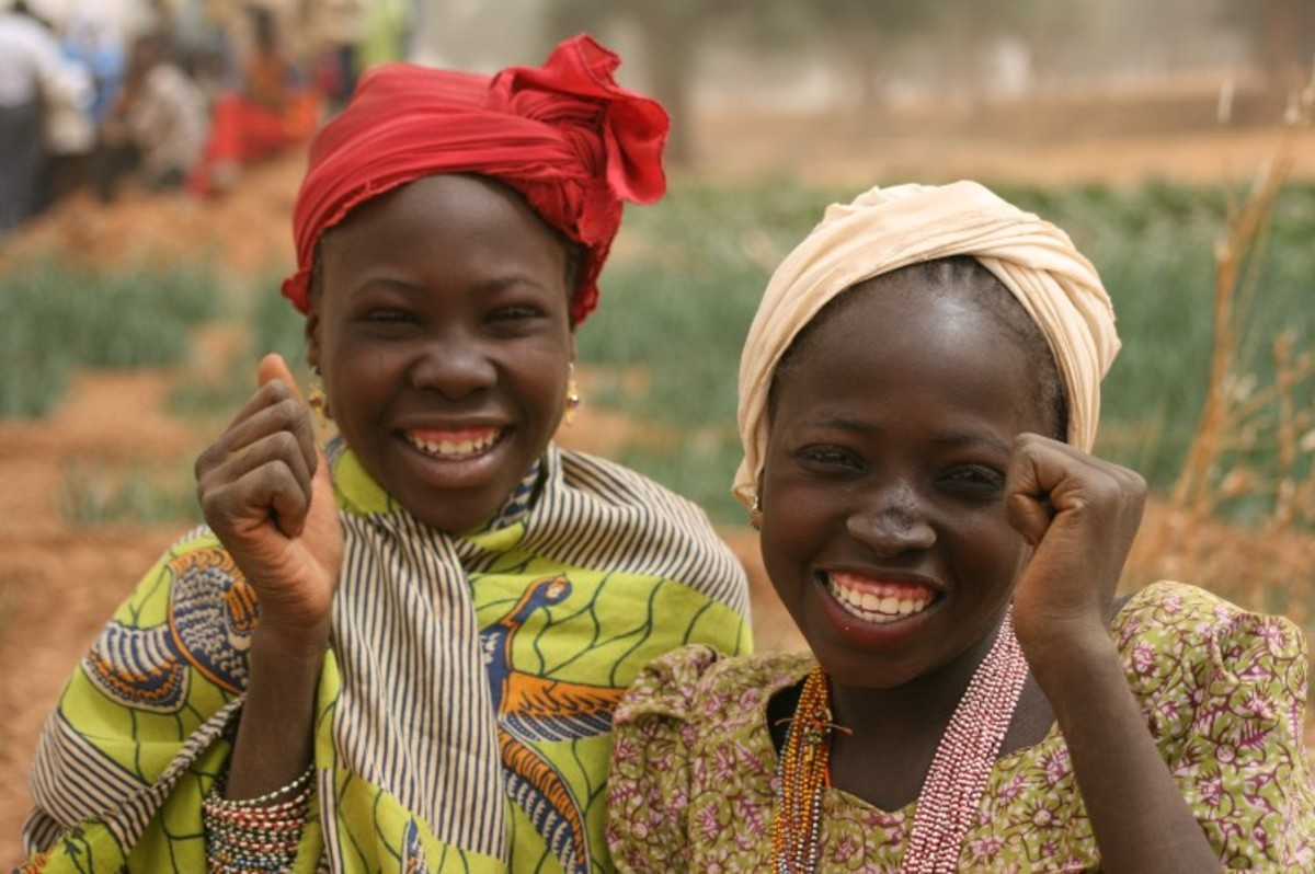 Two girls laughing and having a great time together in Niger, Africa
