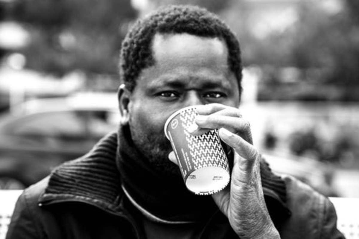 A man drinking green tea