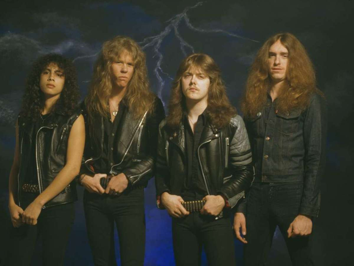 From left to right: Kirk Hammett, James Hetfield, Lars Ulrich, and Cliff Burton. Burton would unfortunately pass away the year after this photo was taken.