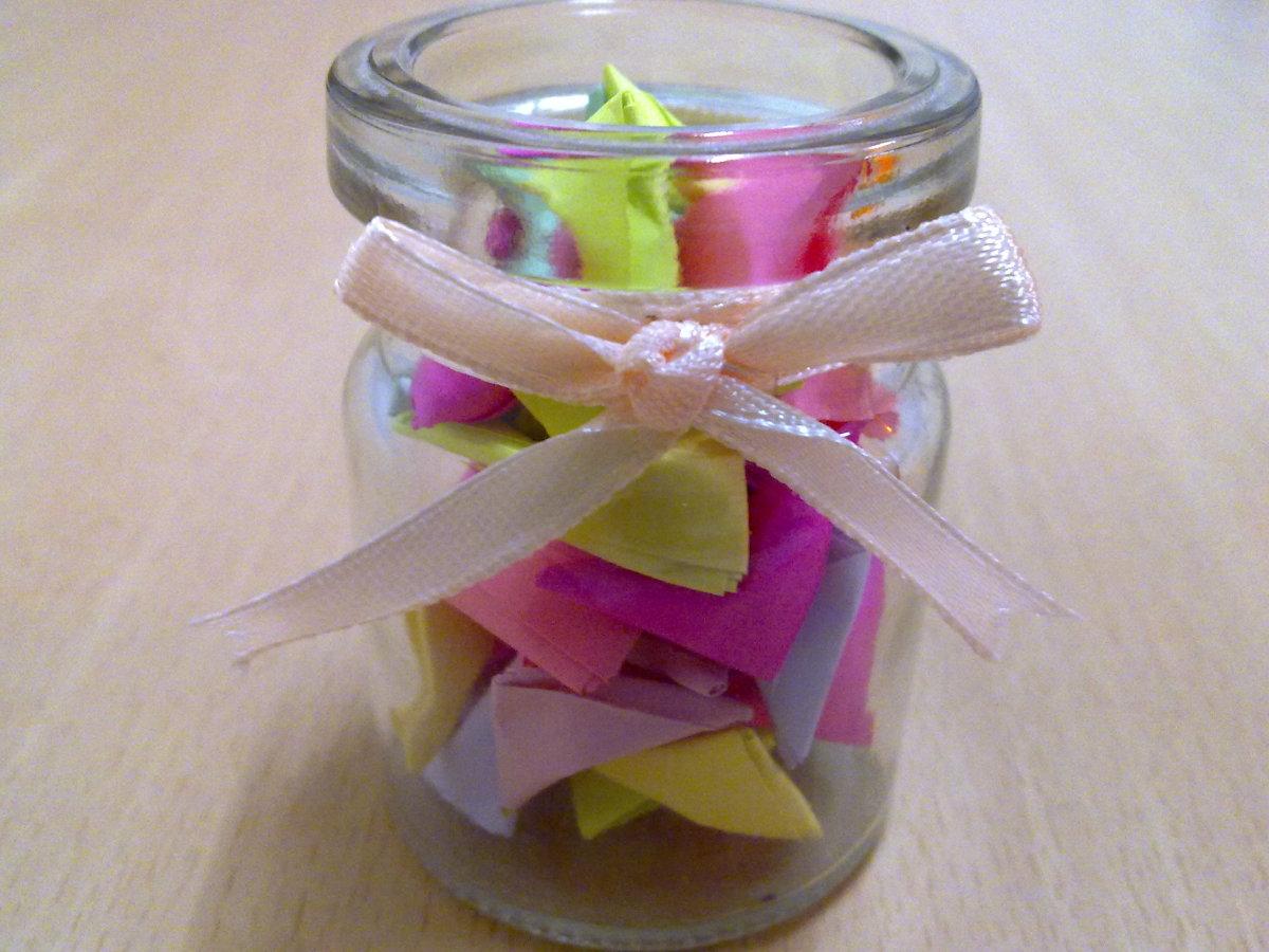 mini paper hearts in a glass bottle