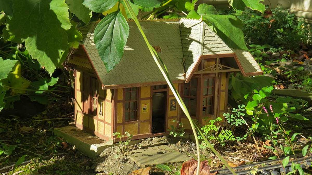 Half-timber house shaded by leaves of Anemone aka Japanese Windflower.