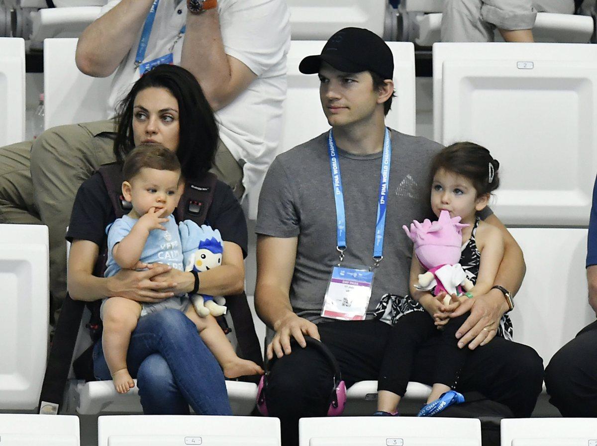 Mila and Ashton with their kids