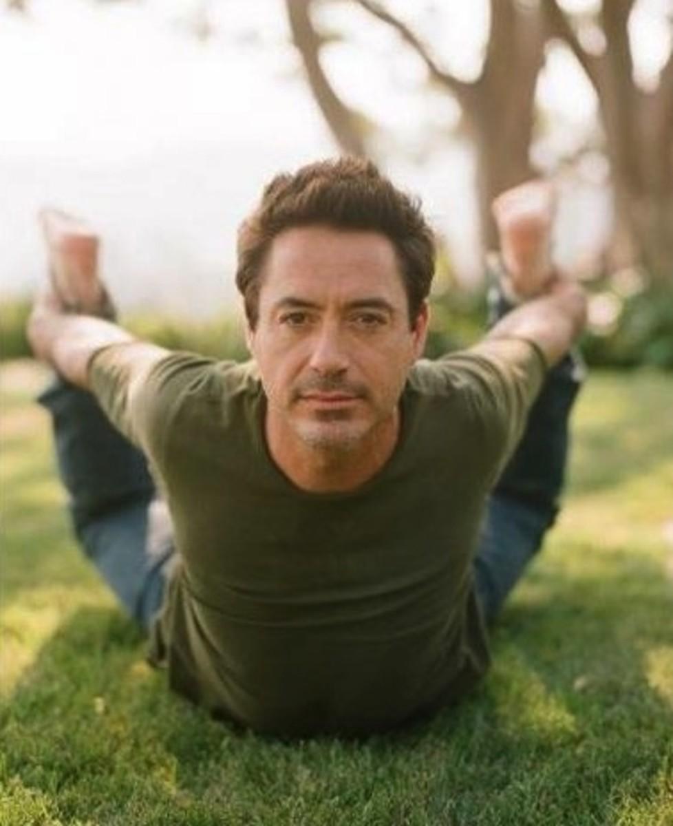 Iron Man (Robert Downey Jr.) doing yoga.
