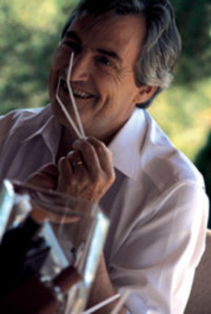Jean-Claude Ellena smelling testing strips.