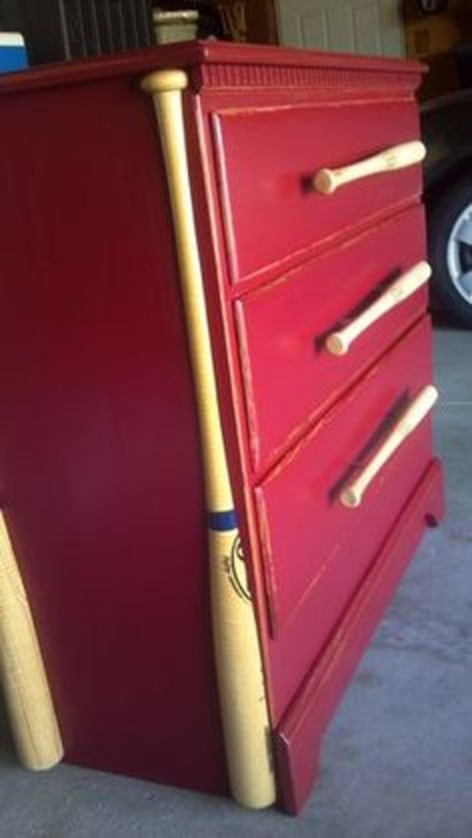 hand painted red baseball themed dresser complete with baseball bats for drawer pulls