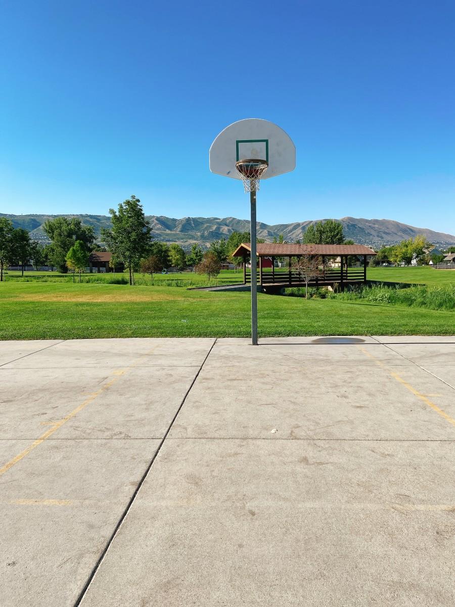 My husband and I play basketball at the park.