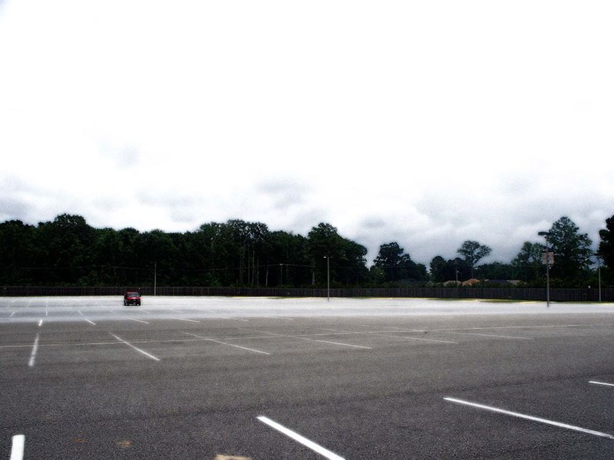 A lone van sits uncomfortably in the desolate parking lot.