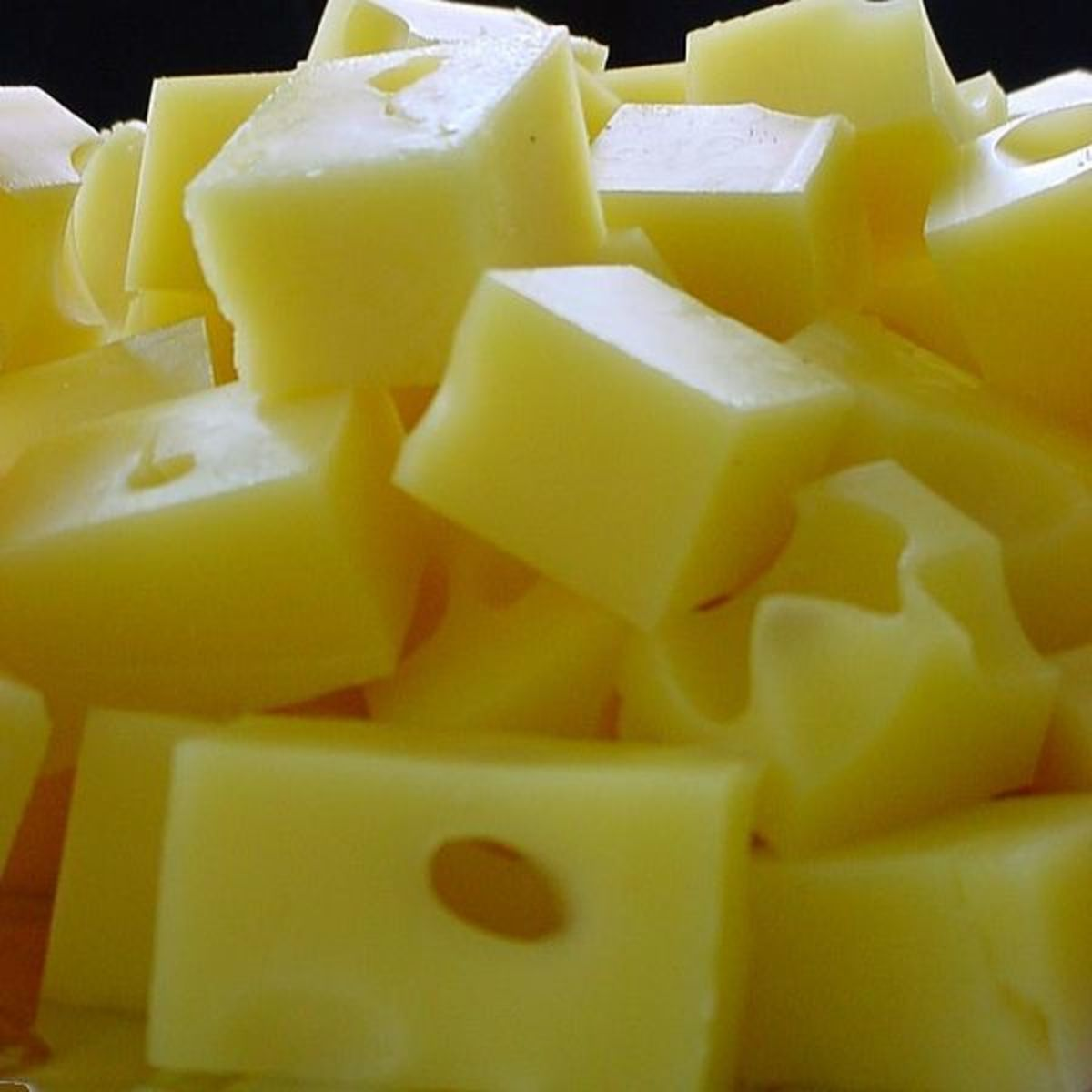 Emmental cheese, one of the Swiss cheese varieties.