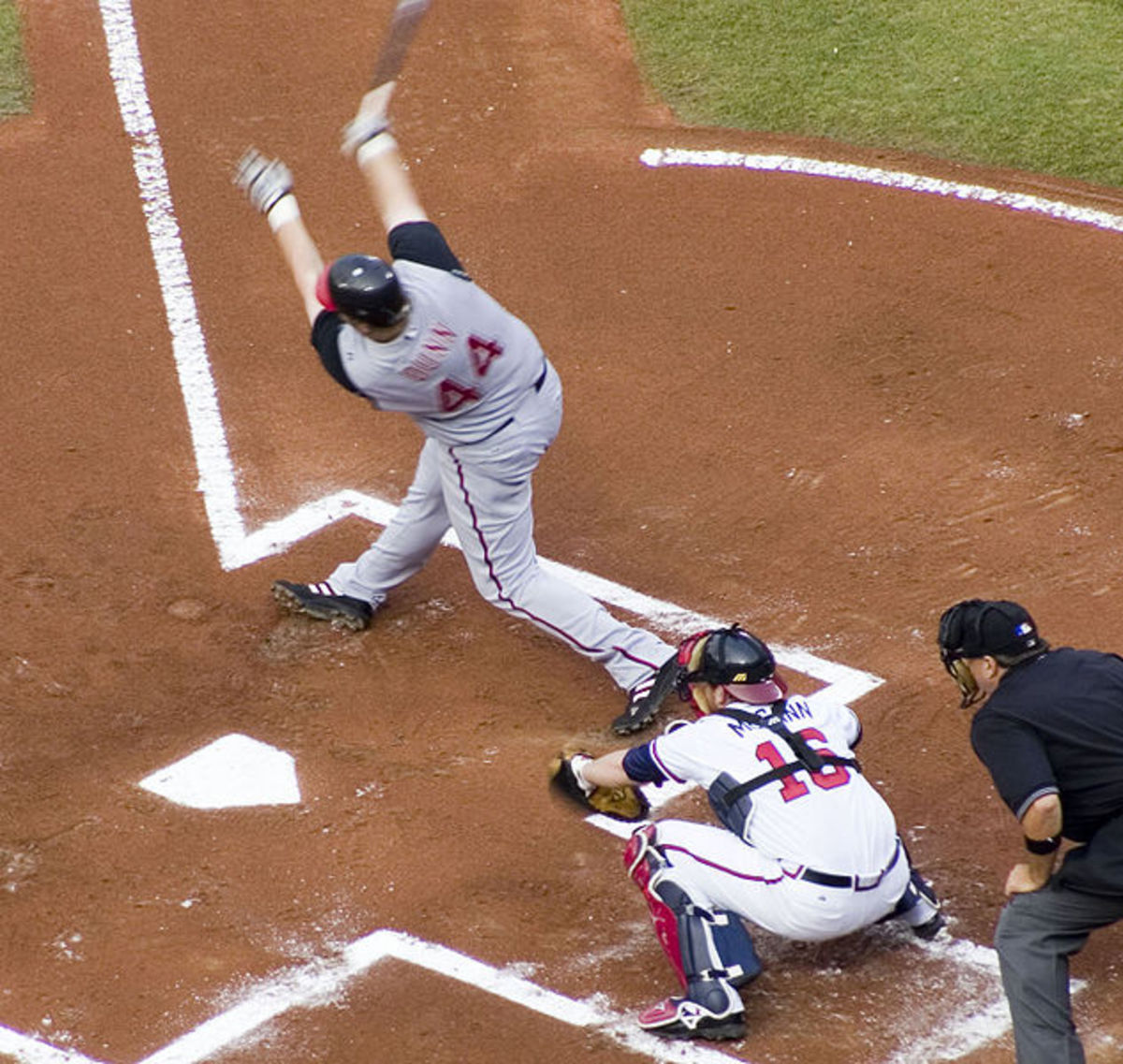Cincinnati Red's outfielder Adam Dunn strikes out swinging to Atlanta Braves pitcher John Smoltz. Braves' catcher Brian McCann catches the pitch behind the plate.